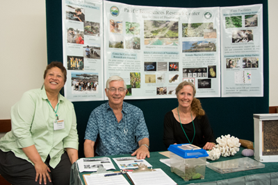 Dr. Healani Chang, Dr. Michael Hadfield, and Dr. Pat Couvillon volunteering at the PBRC booth.