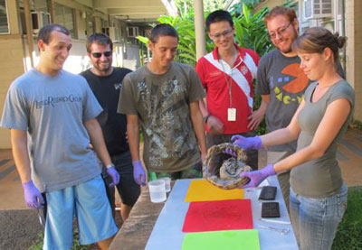 Graduate Student Melissa Wright, and students from the HTSCL and UH Biology program, perform a necropsy on the boa constrictor found on the Pali Highway.  (Photo courtesy of Brenden Holland).