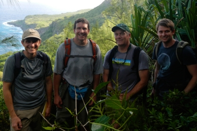 CTAHR Researchers William Haines and Dan Rubinoff, and PBRC researchers Brenden Holland and David Sischo in Guam.  (Photo credit: Brenden Holland).